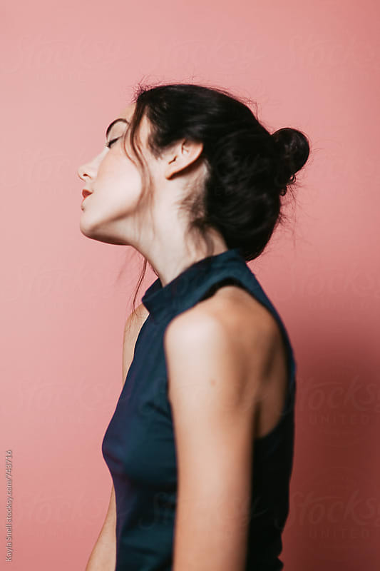Woman tilting her head by Kayla Snell for Stocksy United