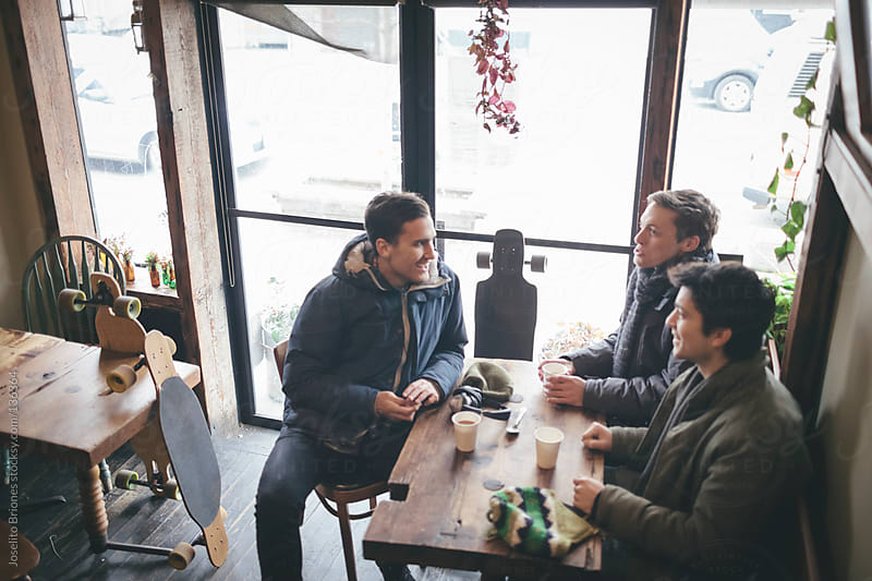 Young Men Friends in a Cafe in Brooklyn by Joselito Briones for Stocksy United
