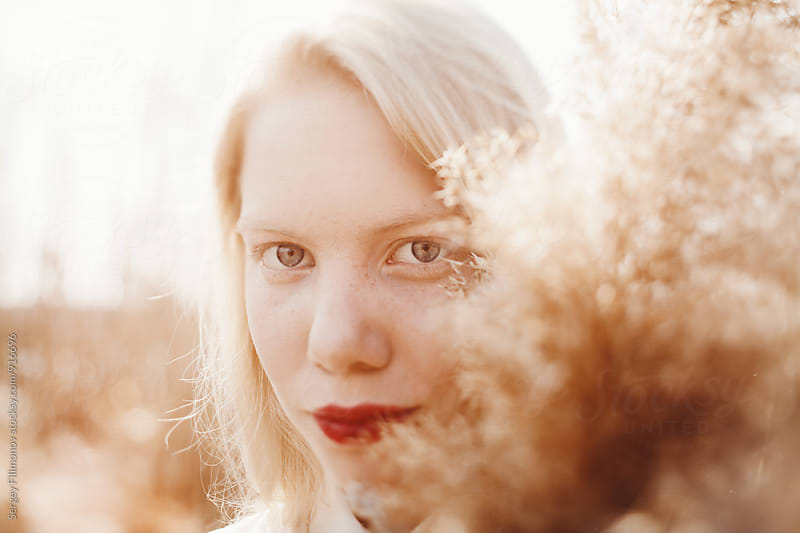 Close up portrait of caucasian woman with bright lips by Sergey Filimonov for Stocksy United