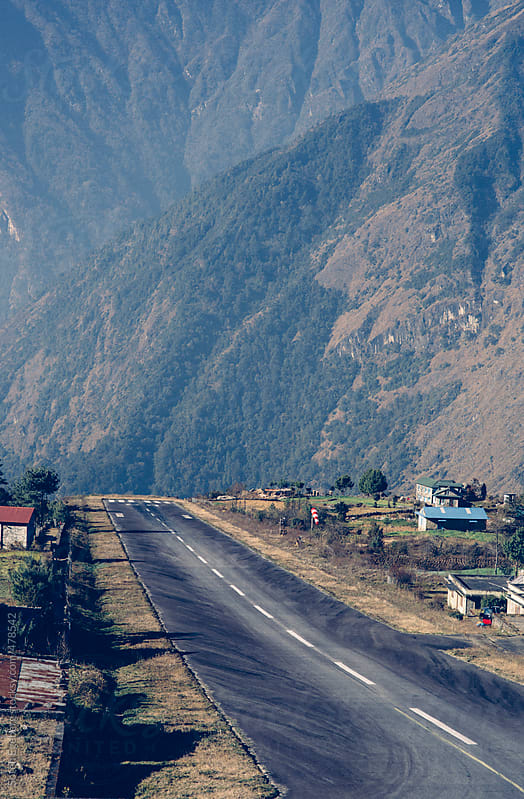 Road to nowhere - the world most dangerous airport and landing strip in Lukla, Nepal Himalayas. by Soren Egeberg for Stocksy United