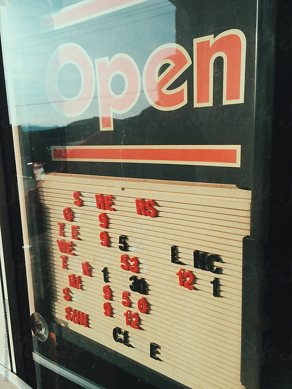 open sign of small shop by Jesse Morrow for Stocksy United