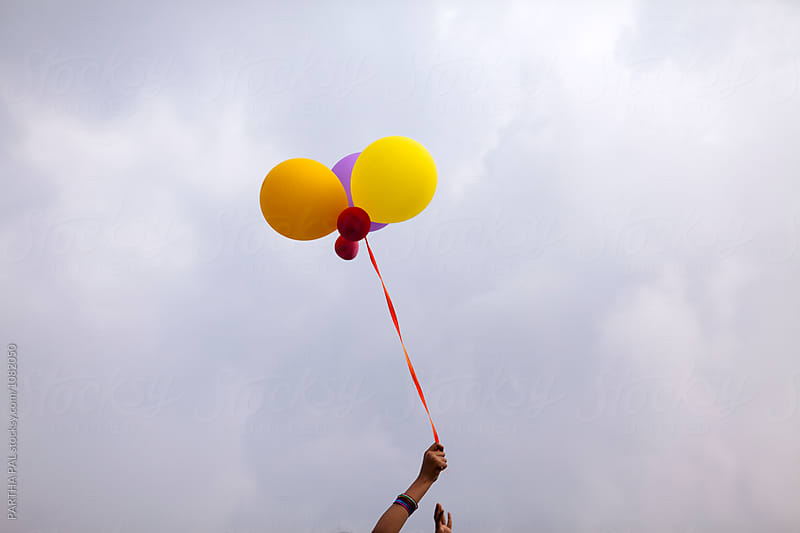 Teenage girl playing with balloon in open air by PARTHA PAL for Stocksy United