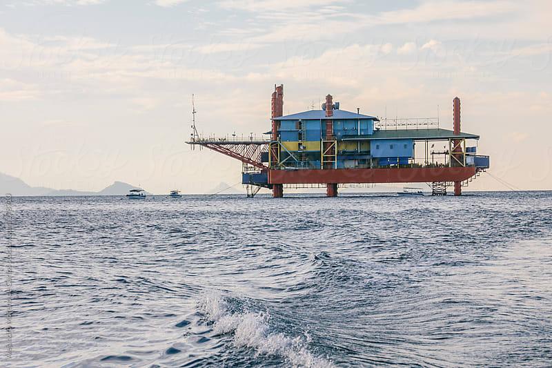 Oil rig on the sea by Alejandro Moreno de Carlos for Stocksy United