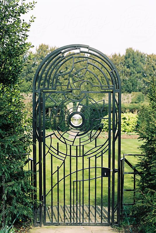 An ornate garden gate by Helen Rushbrook for Stocksy United