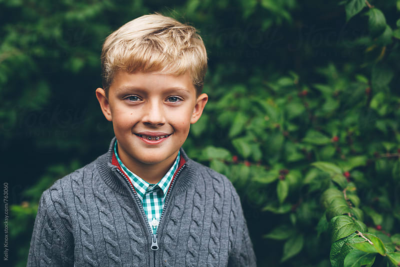 portrait of a boy in autumn by Kelly Knox for Stocksy United