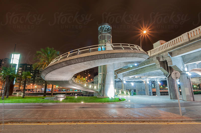Modern urban bridge at night by Marilar Irastorza for Stocksy United