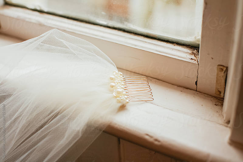 Wedding Veil in a Windowsill by Gabrielle Lutze for Stocksy United
