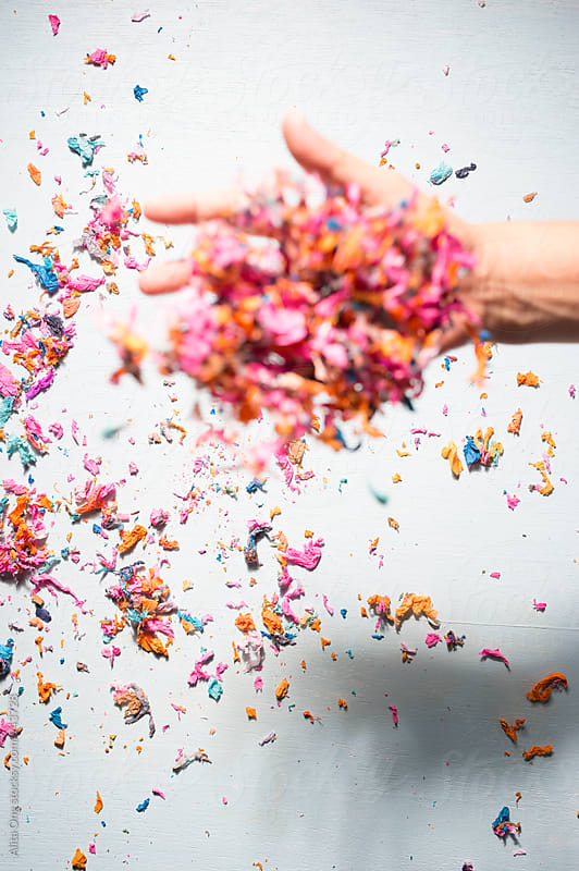Hand tossing confetti by Alita Ong for Stocksy United