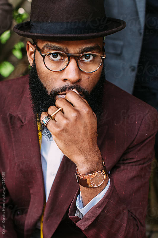 Portrait of a dapper studious gentleman wearing reading glasses by Kristen Curette Hines for Stocksy United