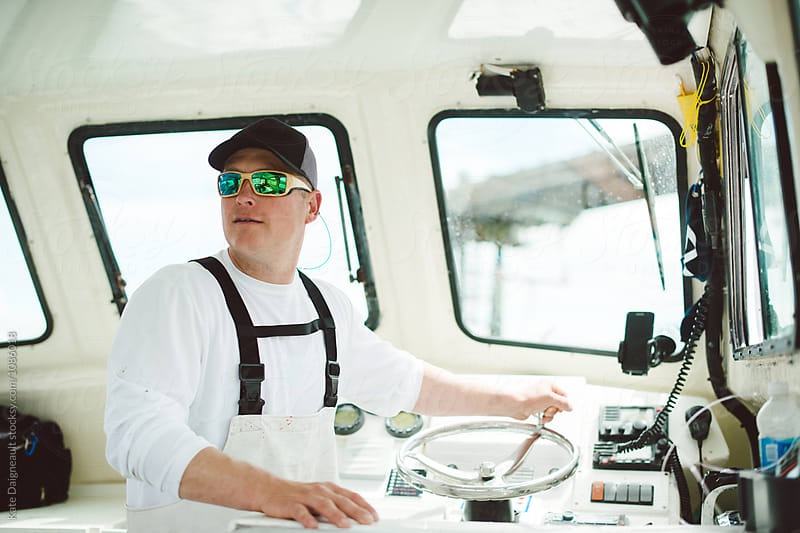 Commercial fishing boat captain by Kate Daigneault for Stocksy United