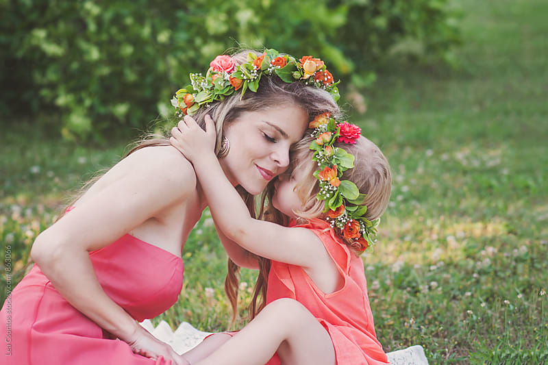 Little girl hugging and kissing her mother by Lea Csontos for Stocksy United