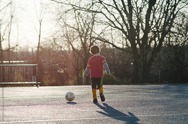 Boy and Soccer by Ali Deck for Stocksy United