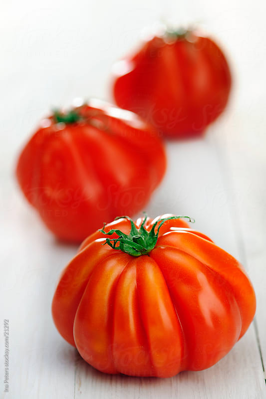 Heirloom (Bull´s Heart) Tomatos by Ina Peters for Stocksy United