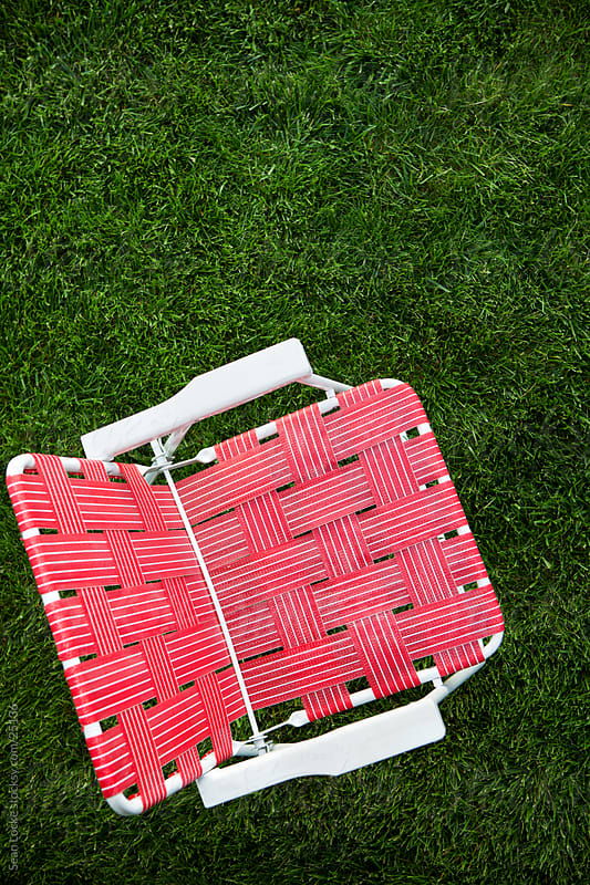 Grass: Empty Folding Chair in Grassy Area by Sean Locke for Stocksy United