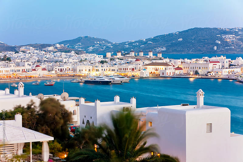 Elevated view over the harbour and old town, Mykonos (Hora), Cyclades Islands, Greece, Europe by Gavin Hellier for Stocksy United