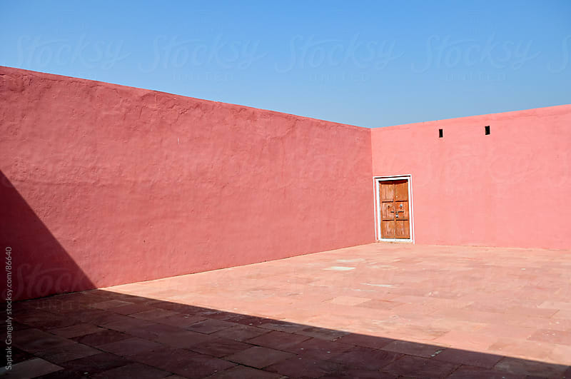 Pink wall and the door by Saptak Ganguly for Stocksy United