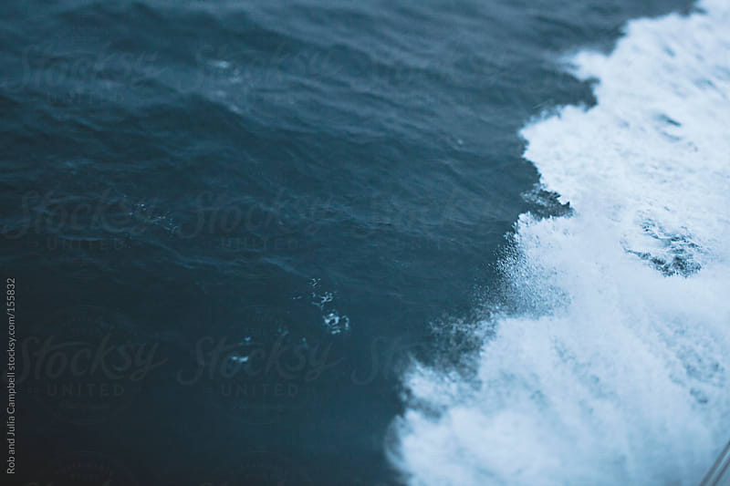 Waves from ferry boat sailing in winter by Rob and Julia Campbell for Stocksy United