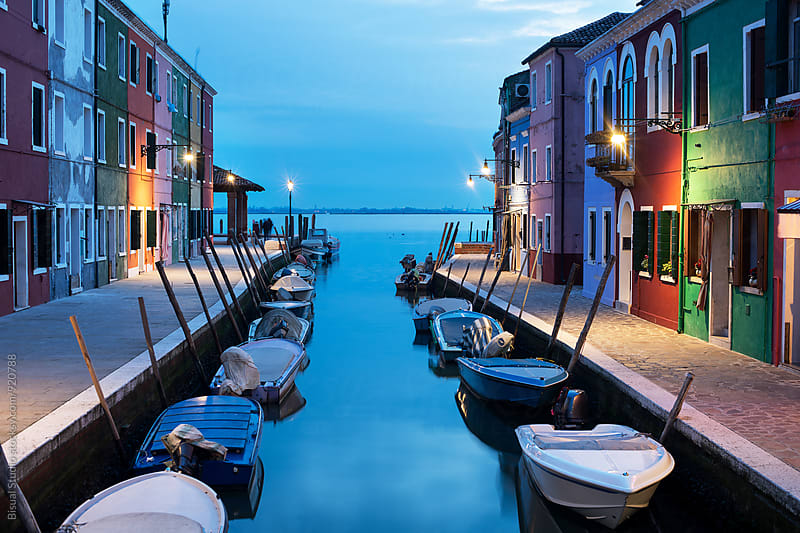 Colorful street in Burano at blue hour by Bisual Studio for Stocksy United