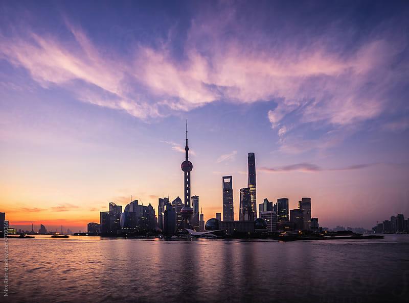 Shanghai sunrise skyline, silhouette by Miss Rein for Stocksy United