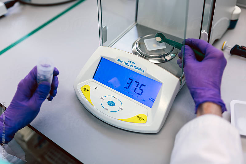 Biologist Using a Digital Scales in the Laboratory by Victor Torres for Stocksy United