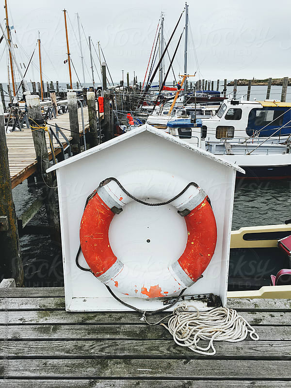 Boat Safety Throw Ring in Small Harbor by Julien L. Balmer for Stocksy United