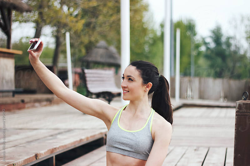 Young woman taking selfie after hard workout in nature by Jovana Rikalo for Stocksy United
