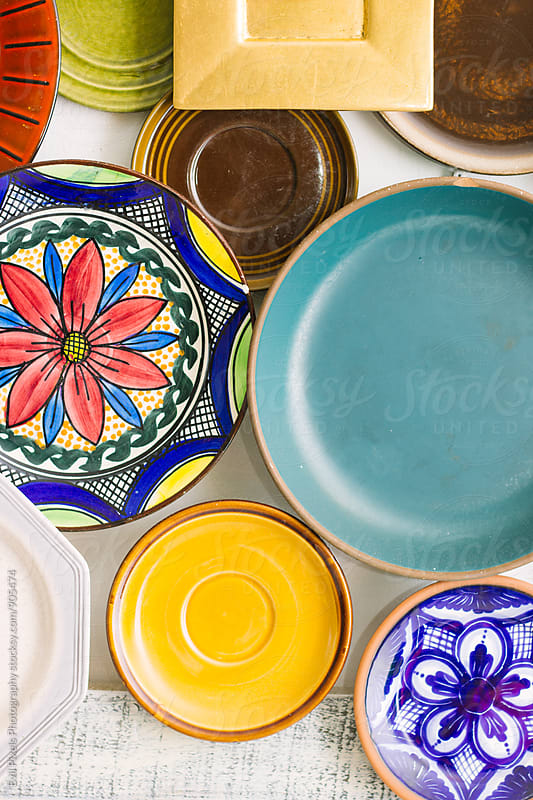 Different plates on the wall by Evil Pixels Photography for Stocksy United