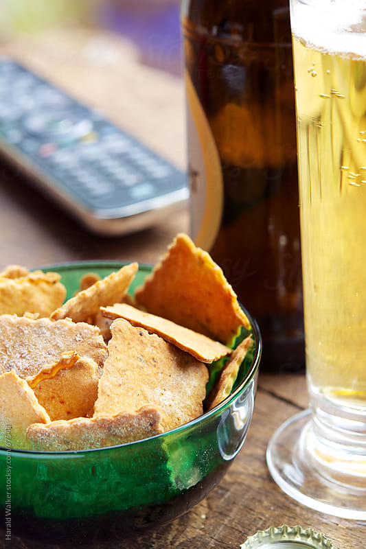 Spicy Chickpea Crackers and beer by Harald Walker for Stocksy United