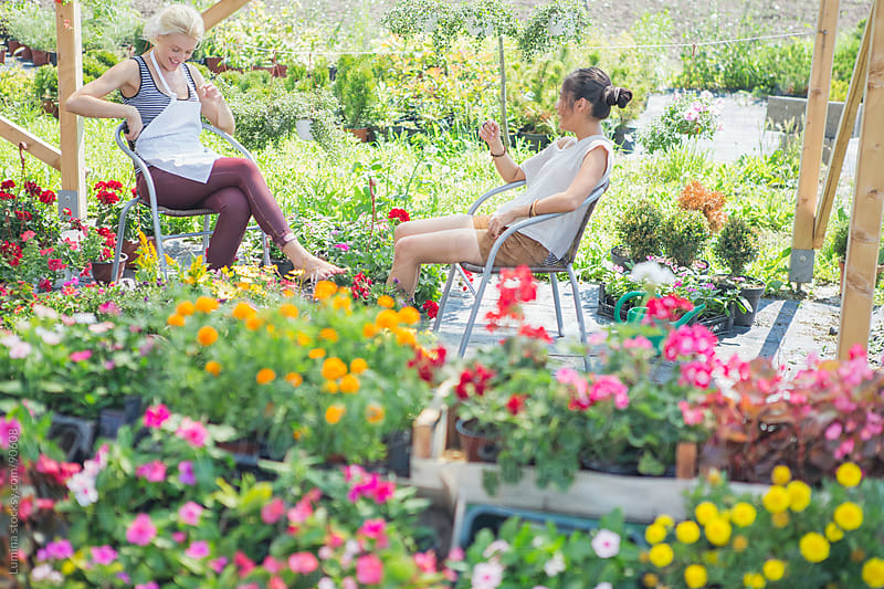 Women Sitting in the Garden by Lumina for Stocksy United
