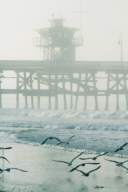 Foogy morning at pier. by RZ CREATIVE for Stocksy United