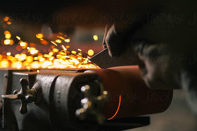 Craftsman Using Belt Sander by L&S Studios for Stocksy United