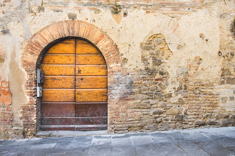 Large Wooden Door in Old Tuscan Village by Giorgio Magini for Stocksy United