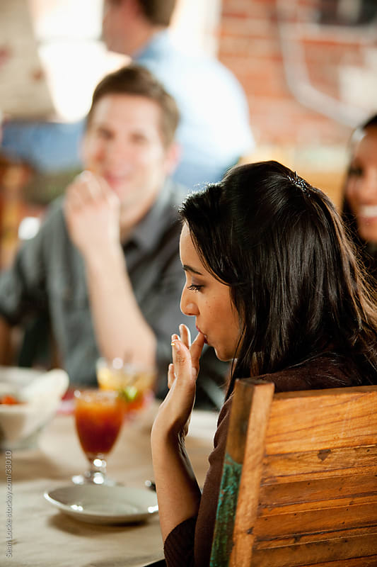 Barbeque: Woman Licks Fingers After Tasting by Sean Locke for Stocksy United