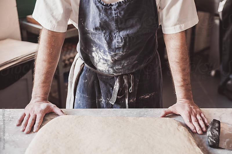 Artisan preparing doughnut dough by Vera Lair for Stocksy United