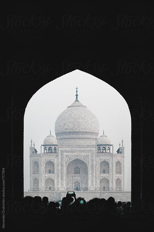 Taj Mahal With Silhouettes From People by Alexander Grabchilev for Stocksy United