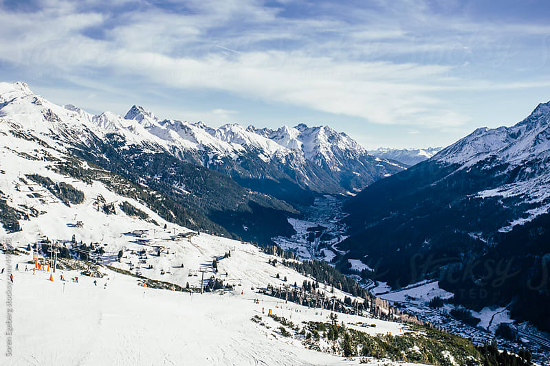 Snow covered mountain valley with ski area in the Austrian Alps in Europe by Soren Egeberg for Stocksy United