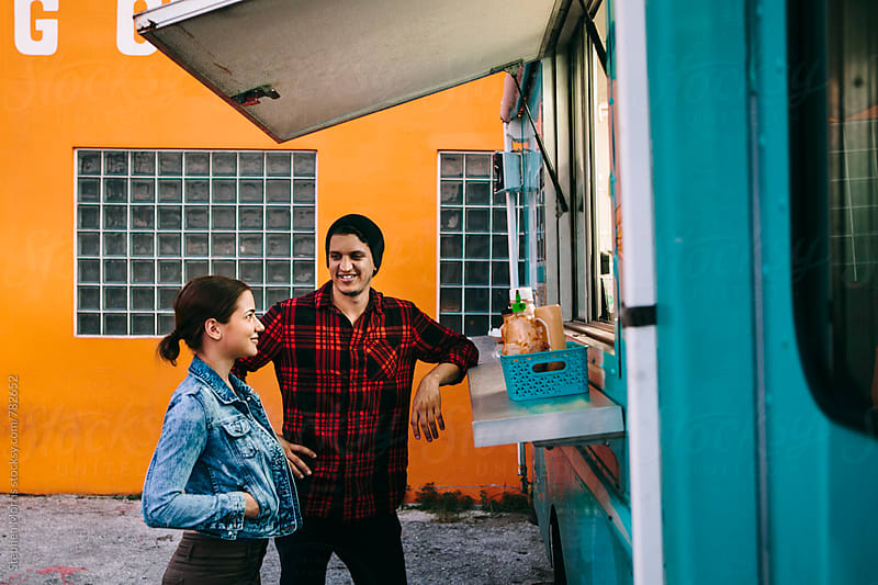 Couple at Food Truck by Stephen Morris for Stocksy United