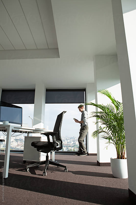 Businessman Using a Tablet at His Office by Lumina for Stocksy United