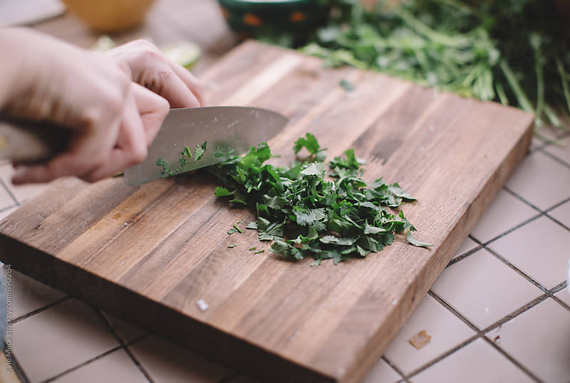 Dicing cilantro  by Kyle Meck for Stocksy United