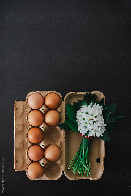 Eggs and a bouqueut of snowdrops on a table  by Marija Mandic for Stocksy United