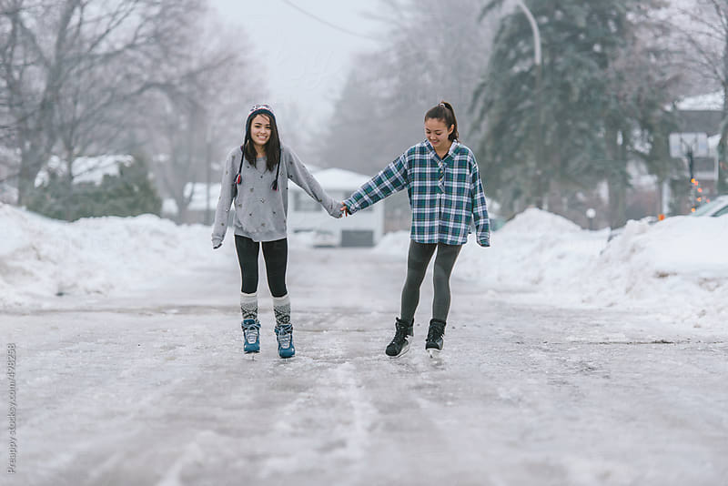 Ice skating on street by Preappy for Stocksy United