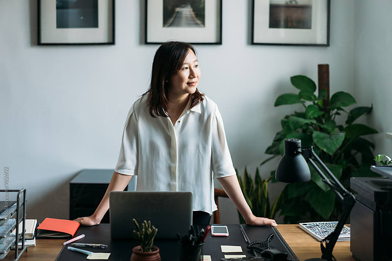 Businesswoman at her office by MaaHoo Studio for Stocksy United