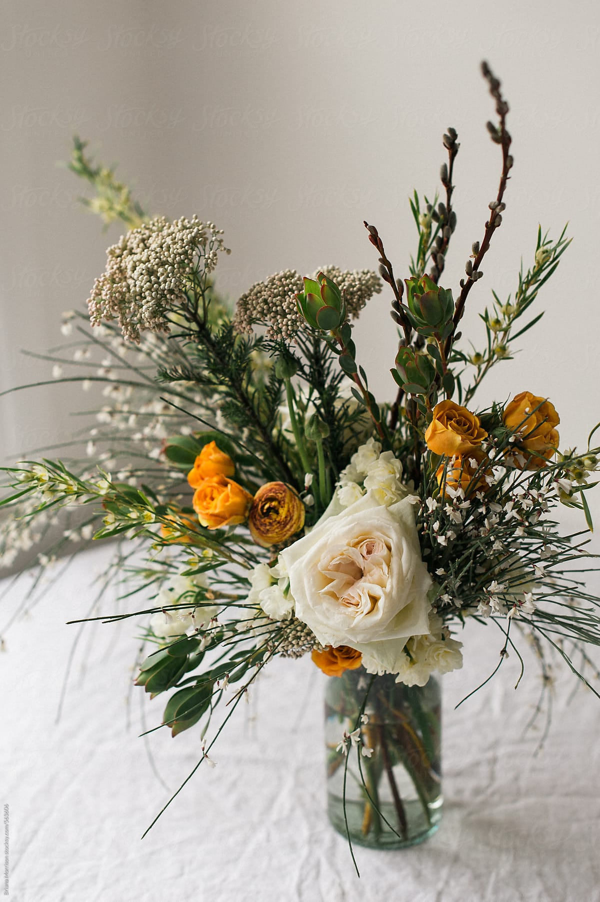 Spring Floral Arrangement With White Green And Orange Foliage