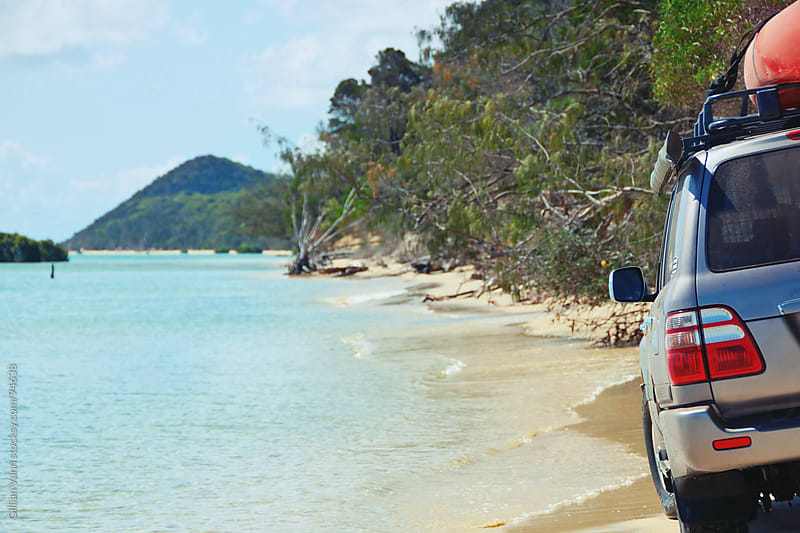 4x4 beach driving on Moreton Island, against the tide by Gillian Vann for Stocksy United