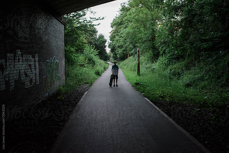 boy skating on cycling path by Léa Jones for Stocksy United