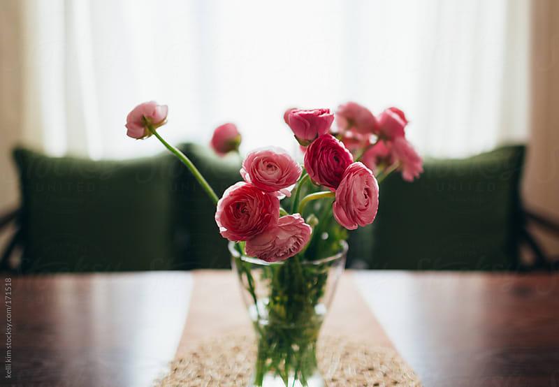 Vase of Pink Ranunculus Flowers On Table by Kelli Seeger Kim for Stocksy United