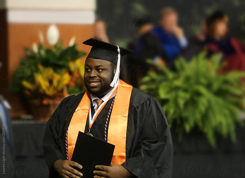 Black Man Graduation Cap and Gown | Stocksy United