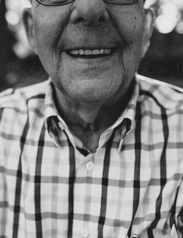 Happy, smiling portrait of senior man outside by Rob and Julia Campbell for Stocksy United