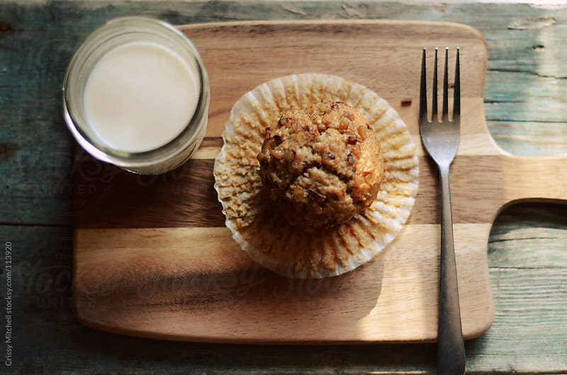 A muffin and milk by Crissy Mitchell for Stocksy United
