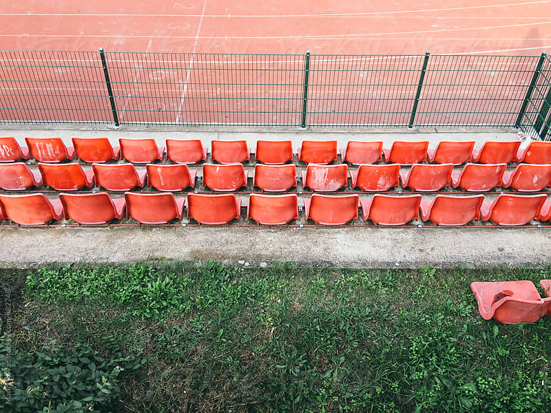 Bleacher, red chairs - horizontal by Marija Kovac for Stocksy United